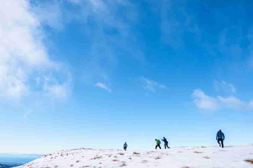 Hiking the snowy mountains of Kahurangi National Park. (Photo via Shutterstock)