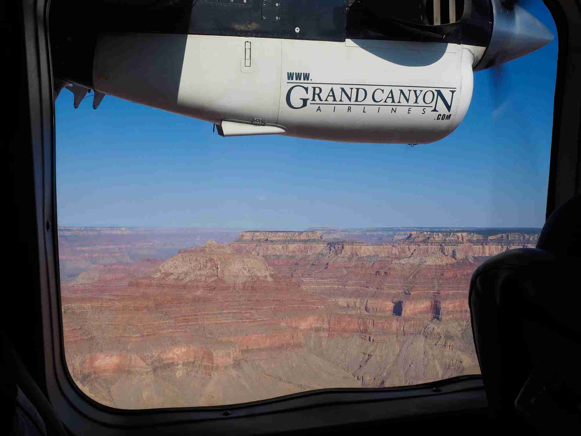 A charter flight sightseeing above the Grand Canyon National Park (Photo by Thamerpic/Getty Images).