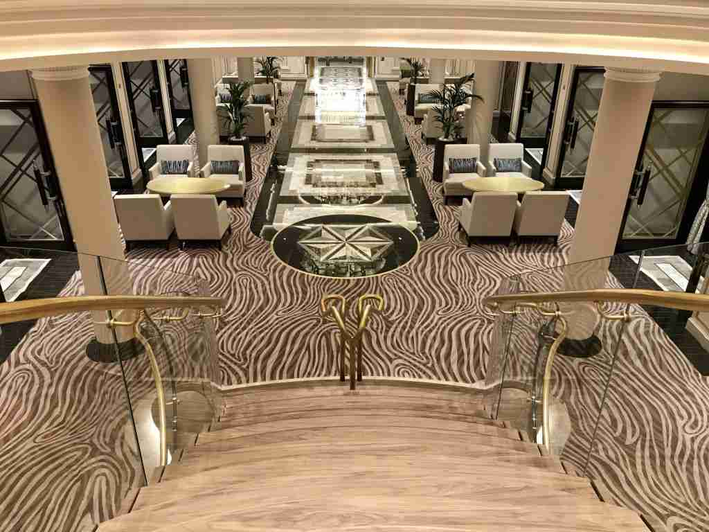 The grand staircase at the center of Seven Seas Splendor
