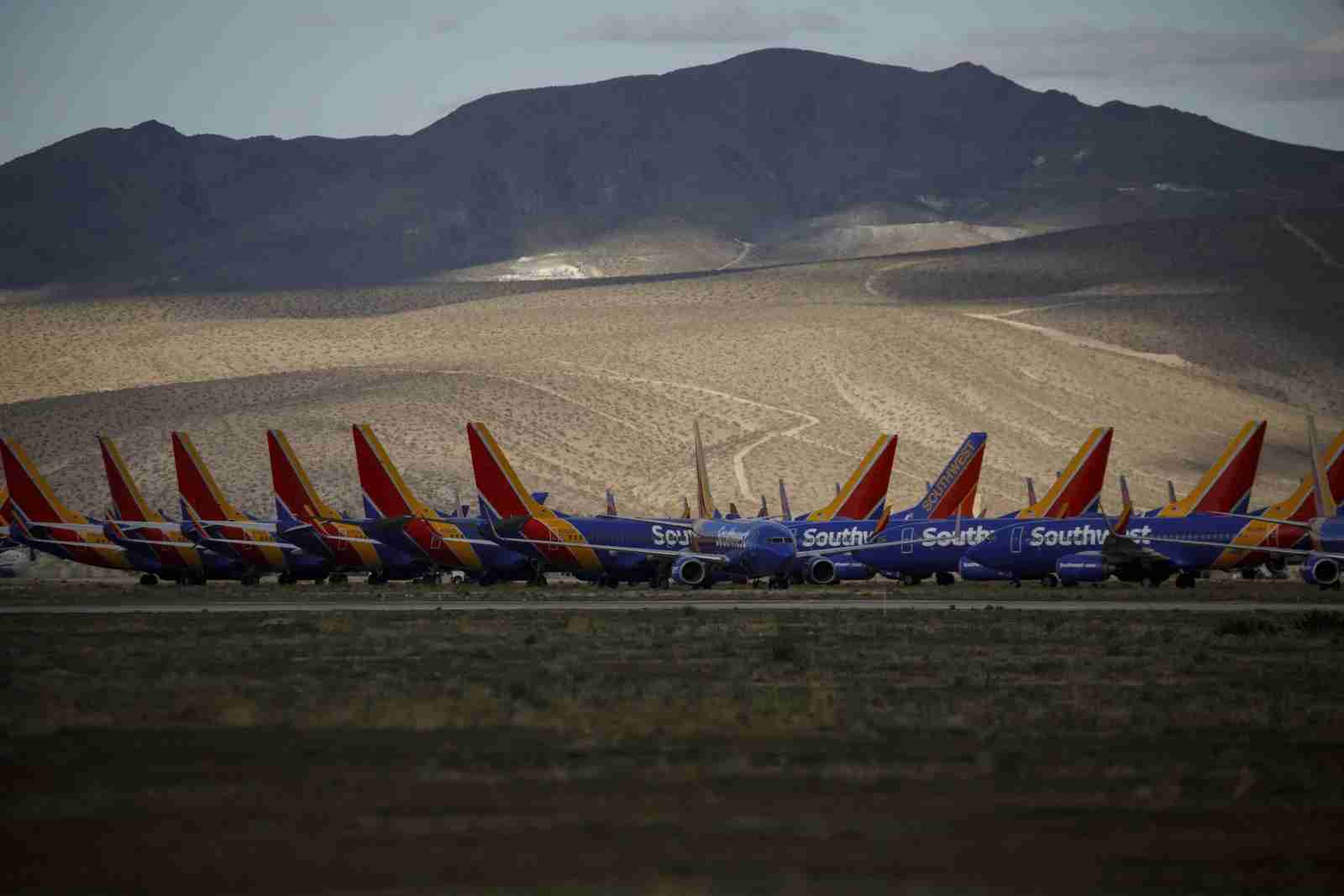 Southwest Airlines Co. aircraft sit parked at a field in Victorville, California, U.S., on Monday, March 23, 2020. Southwest, which carries the most passengers in domestic markets, said it will cut 1,000 daily flights starting Sunday, ahead of a previously planned 20% capacity reduction, because of a rapid drop in near-term demand. (Photo by Patrick T. Fallon/Bloomberg/Getty Images)