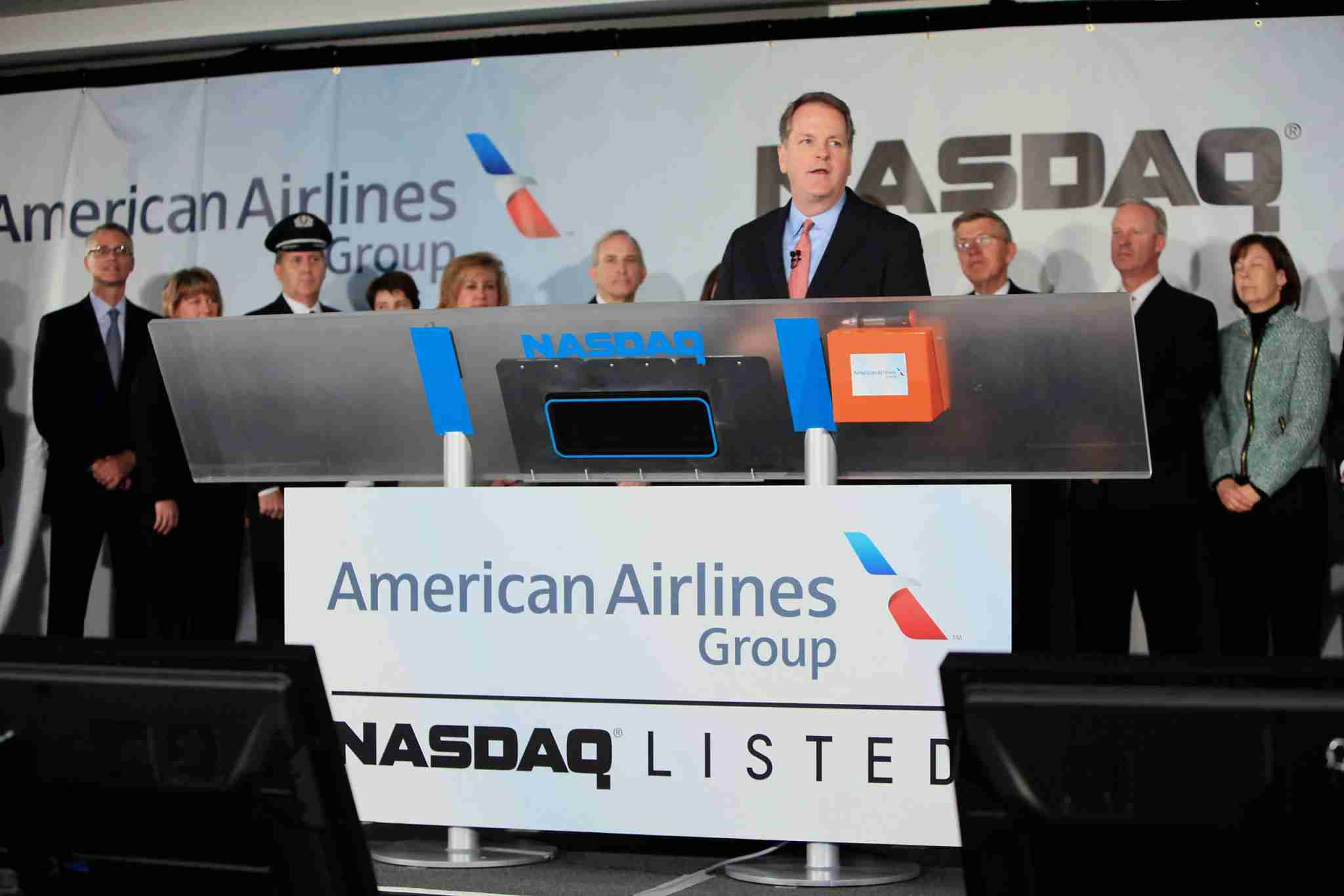 """Douglas """"Doug"""" Parker, chief executive officer of the newly formed American Airlines Group Inc., speaks before remotely ring the opening bell of the Nasdaq MarketSite at American Airlines headquarters in Fort Worth, Texas, U.S., on Monday, Dec. 9, 2013. American Airlines Group Inc., formed today when AMR Corp. and US Airways Group Inc. combined, is poised to rise on confidence that the worlds largest carrier can avoid the pitfalls that dragged down other mergers. Photographer: Ben Torres/Bloomberg via Getty Images"""