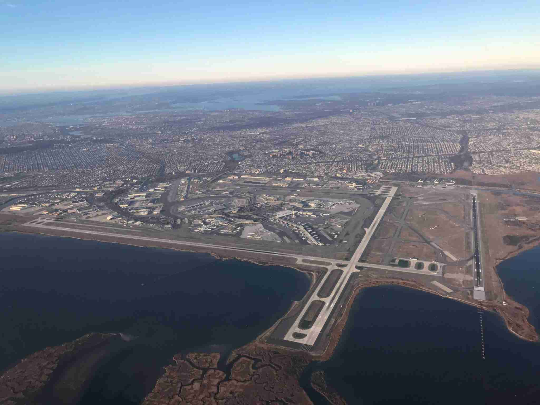An aerial view of John F. Kennedy International Airport Airport is seen from a plane overNew York City on December 4, 2016. / AFP / Daniel SLIM (Photo credit should read DANIEL SLIM/AFP via Getty Images)