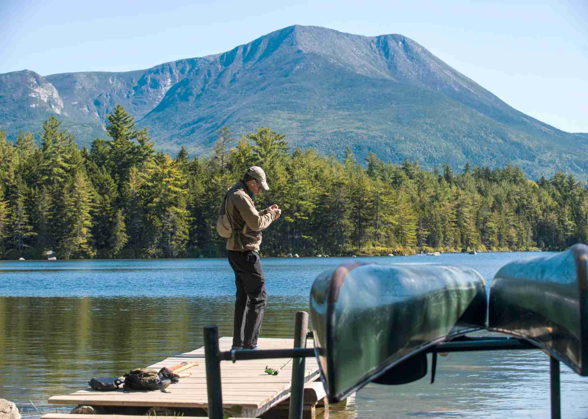 Fly fisherman at Kidney Pond in Baxter State Park, Maine. (Photo by Joe Klementovich/Getty Images)