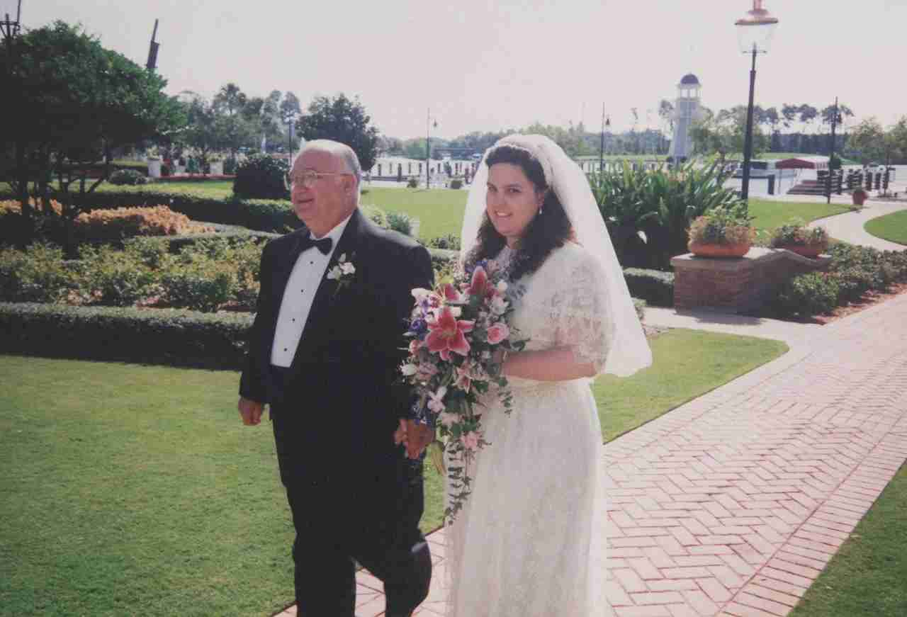 My dad walking me down the aisle to the Rose Garden Gazebo at Disney