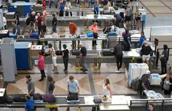 DENVER, COLORADO - AUGUST 30, 2019: Airport passengers proceed through the TSA security checkpoint at Denver International Airport in Denver, Colorado. (Photo by Robert Alexander/Getty Images)