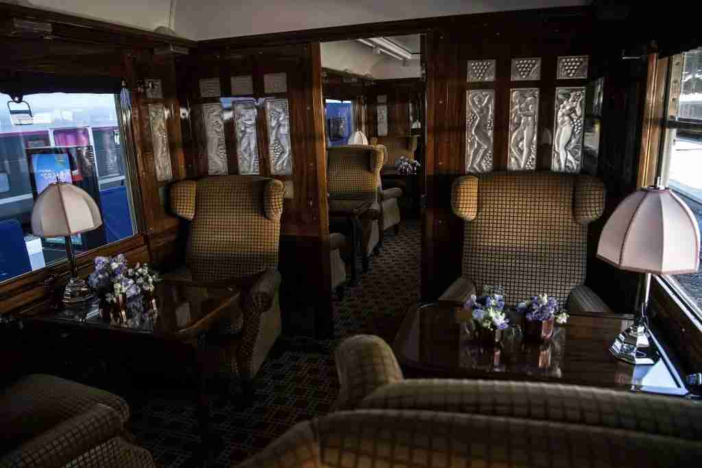 This picture taken on May 13, 2019 shows the interior of a carriage in a restored carriage of an Orient Express train displayed at the Gare de l
