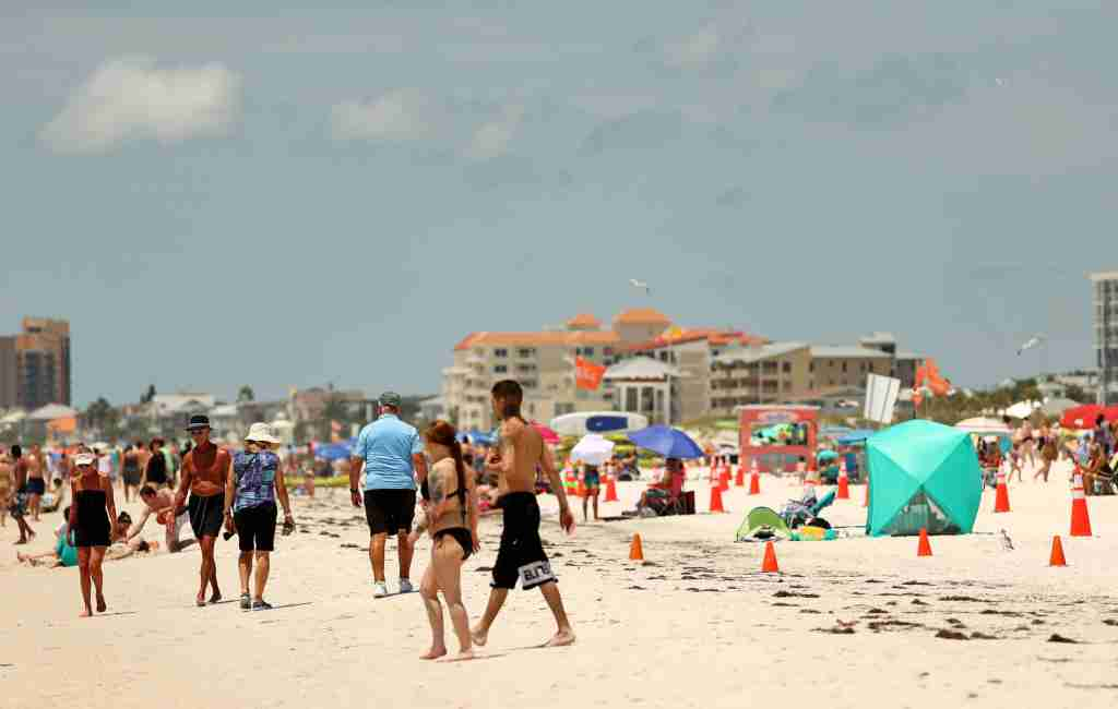 People visit Clearwater Beach on May 20, 2020 in Florida. (Photo by Mike Ehrmann/Getty Images)