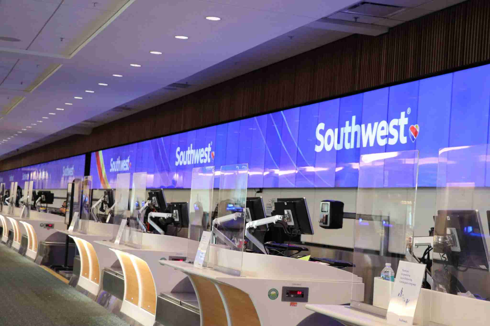 Plastic protective barriers are now in place at check-in counters at Orlando International Airport, including for Southwest. (Image courtesy of Orlando International Airport)