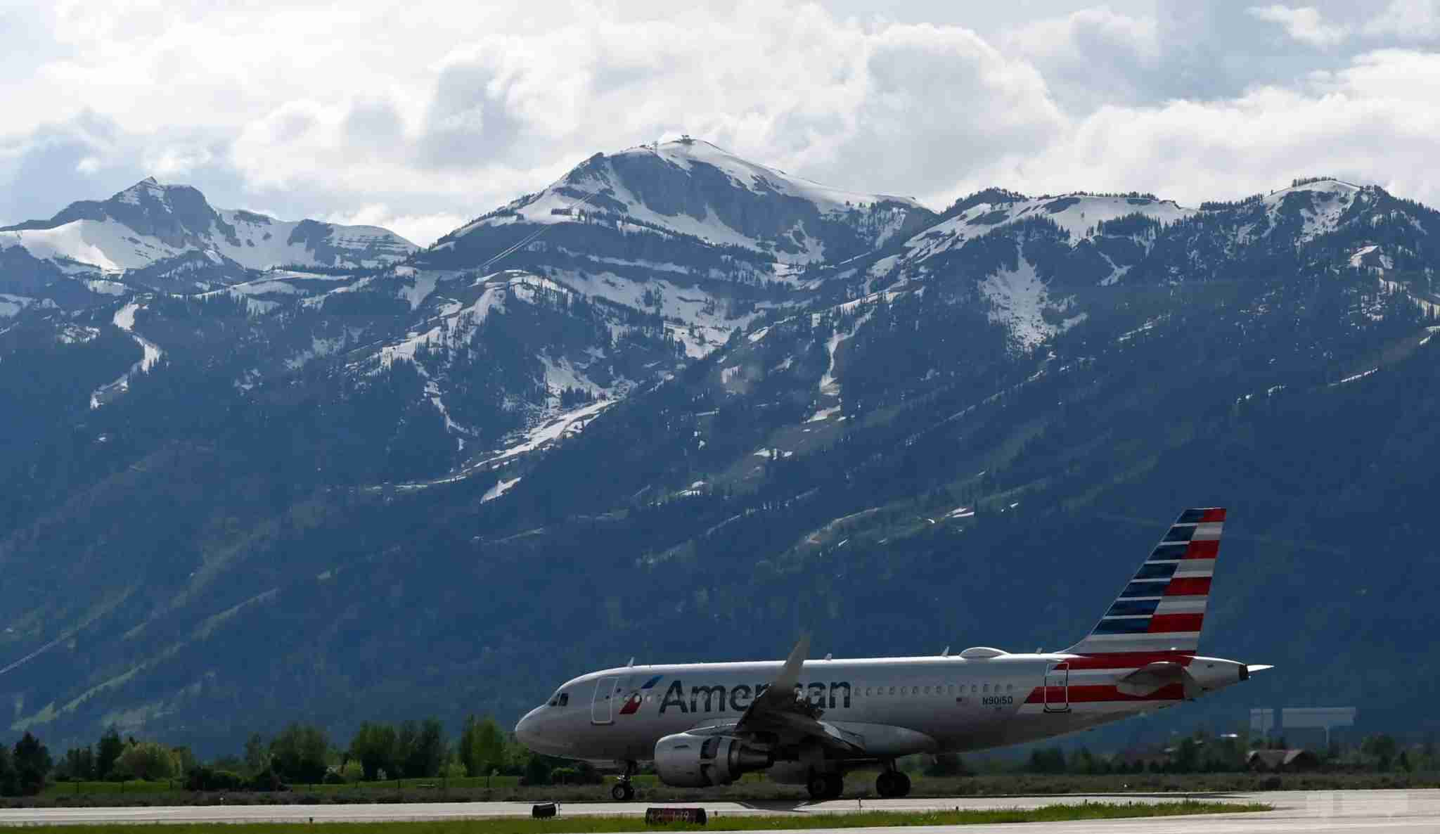 An Airbus A319-115 of American Airlines on the tarmac at off from Jackson Hole Airport in Grand Teton National Park, Wyoming, on June 13, 2019. (Photo by Daniel SLIM / AFP) (Photo credit should read DANIEL SLIM/AFP via Getty Images)