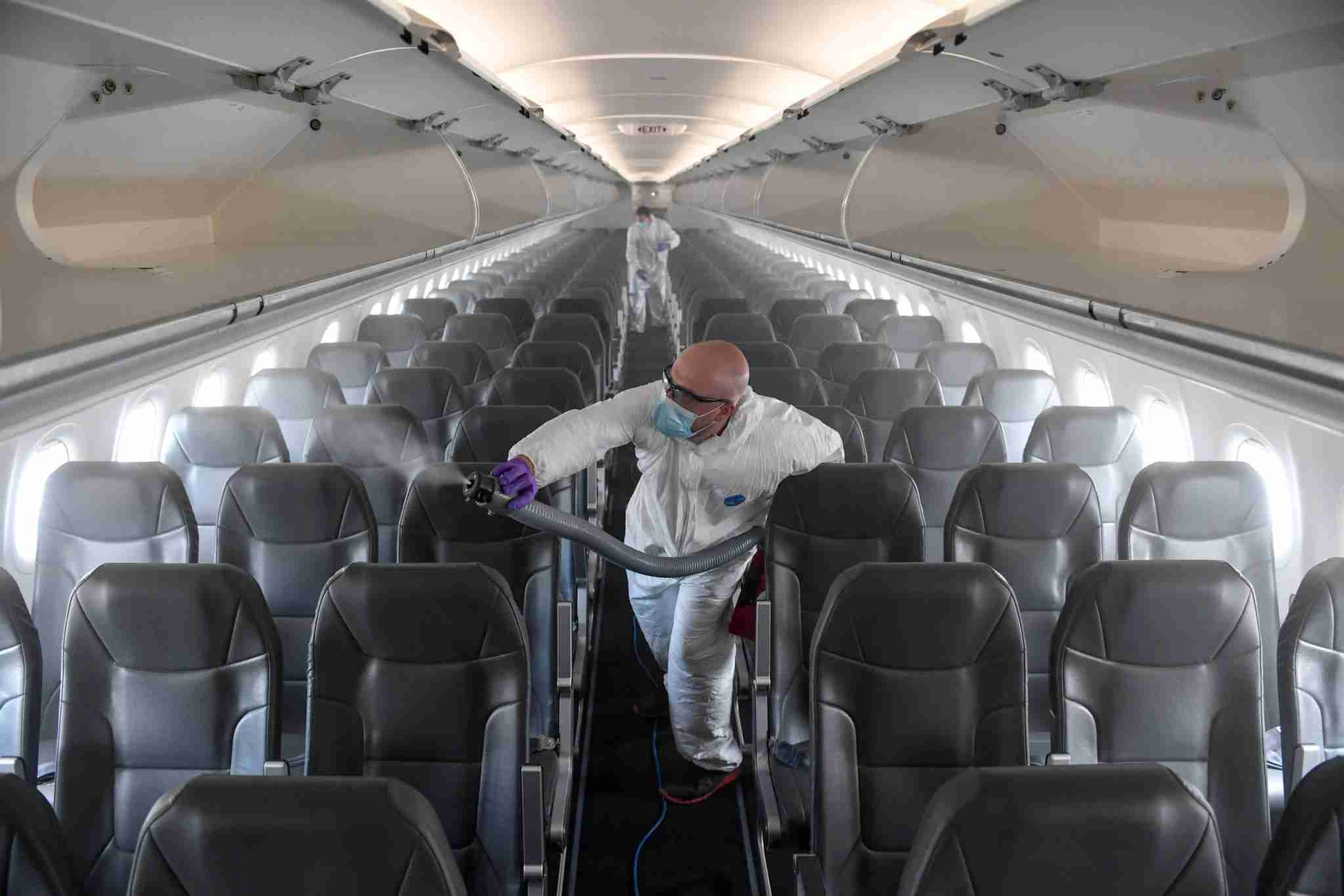 DENVER, CO - MAY 6: Brandon Wilson, owner of AvidJet, disinfects a Frontier airplane with a fogger at Denver International Airport on Tuesday, May 6, 2020. ProShield, the microbiostatic agent used to disinfect the plane, will keep the aircraft clean for up to 90 days after application. Beginning this week, Frontier will require the use of masks by passengers and will implement temperature checks in the coming weeks. (Photo by AAron Ontiveroz/MediaNews Group/The Denver Post via Getty Images)