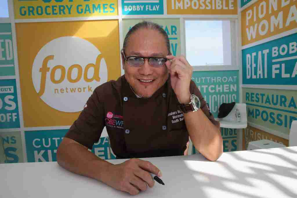 MIAMI BEACH, FL - FEBRUARY 22: Chef Masaharu Morimoto signs books at the KitchenAid Culinary Demonstrations during the 2015 Food Network & Cooking Channel South Beach Wine & Food Festival presented by FOOD & WINE at Grand Tasting Village on February 22, 2015 in Miami Beach, Florida. (Photo by Aaron Davidson/Getty Images for SOBEWFF)