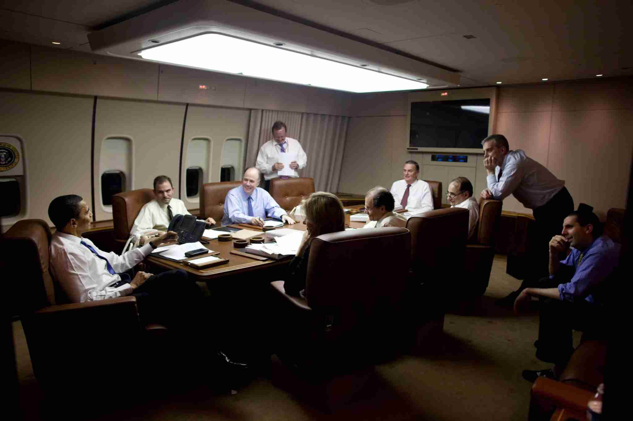 IN FLIGHT - APRIL 5: In this handout provide by the White House, U.S. President Barack Obama (L) talks with his staff aboard Air Force One during the flight from Prague, Czech Republic en route to Ankara, Turkey on April 5, 2009 in flight. Obama is serving as the 44th President of the U.S. and the first African-American to be elected to the office of President in the history of the United States. (Photo by Pete Souza/White House via Getty Images)