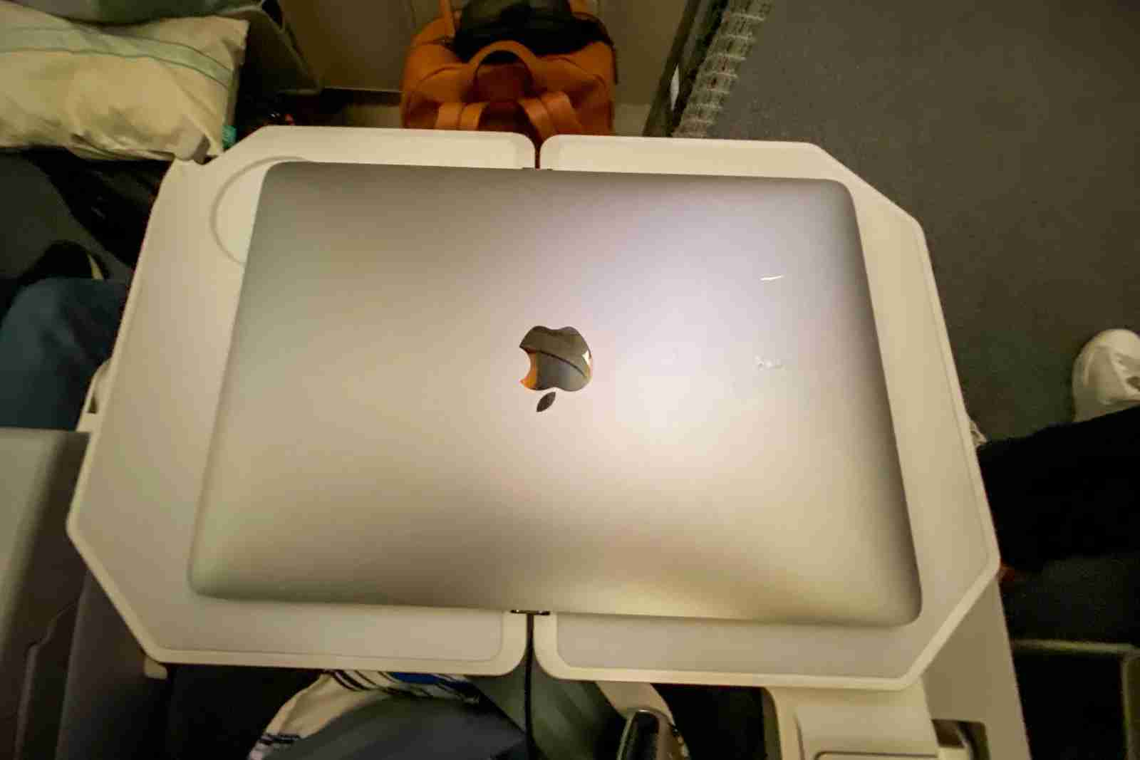"""My 12"""" Mac on the foldable tray table (Photo by Chris Dong/The Points Guy)"""