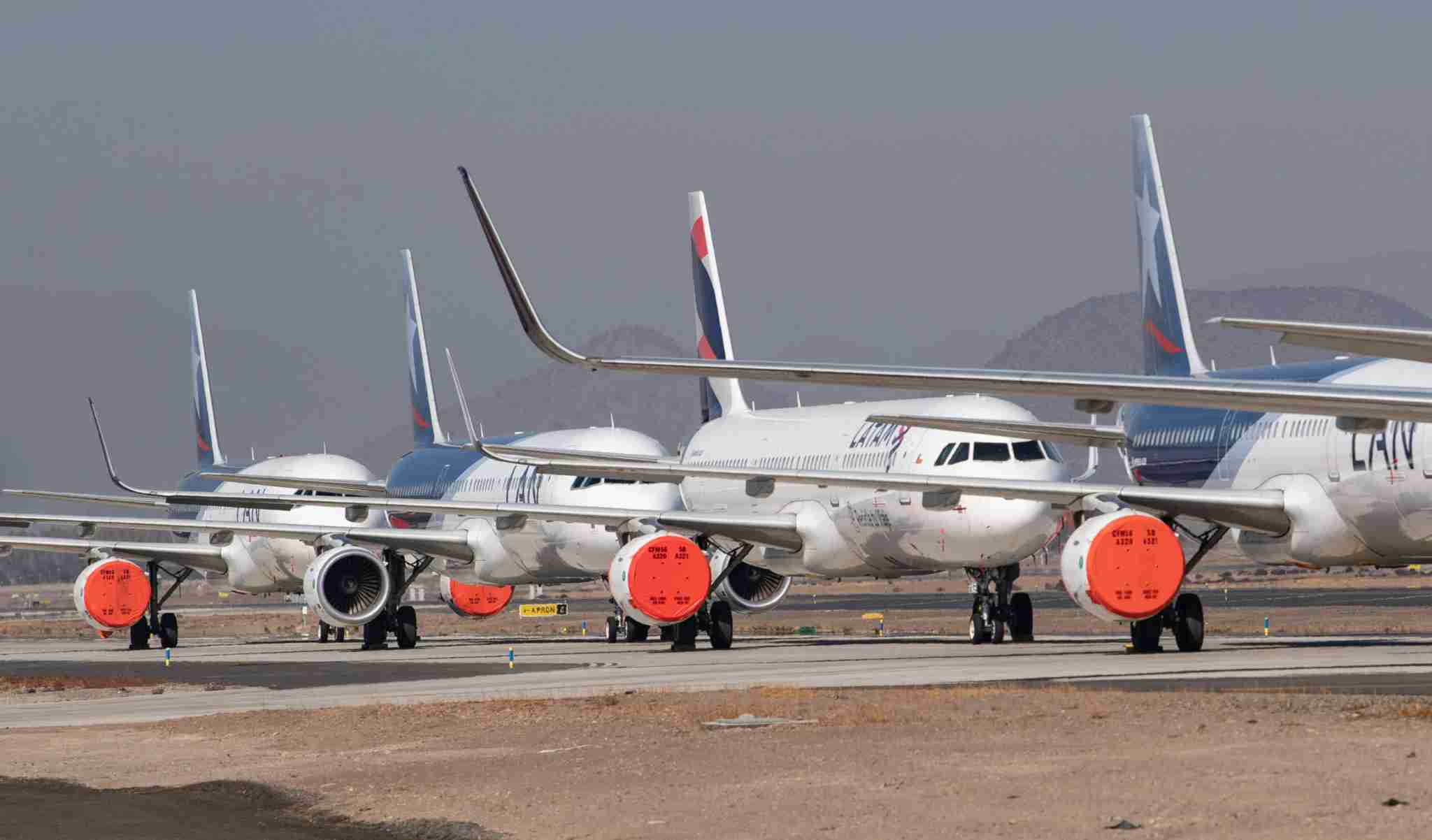 Aircrafts of Latam airline sit on the tarmac at Santiago International Airport, in Santiago, on April 20, 2020 during the new coronavirus, COVID-19, pandemic. - Latin America