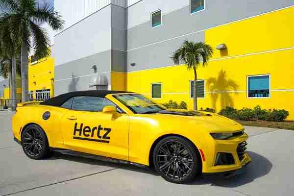 Yellow Hertz Branded Camero Outside Hertz Building