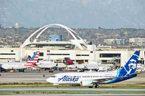 Airplanes at LAX Airport with Alaska Airlines 737 in Front