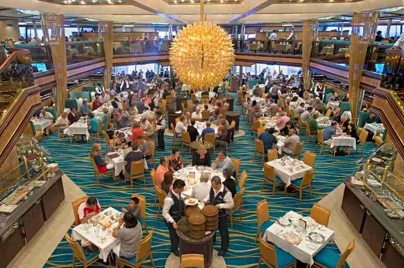 """Carnival Sunshine offers two full-service dining rooms, the Sunset Restaurant located forward and the Sunrise Restaurant shown here that offers """"Your Time Dining."""" (Andy Newman/Carnival Cruise Lines)"""