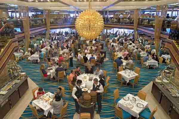 "Carnival Sunshine offers two full-service dining rooms, the Sunset Restaurant located forward and the Sunrise Restaurant shown here that offers ""Your Time Dining."" (Andy Newman/Carnival Cruise Lines)"