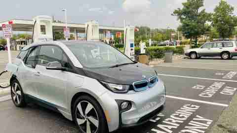 BMW i3 charging at a public charger