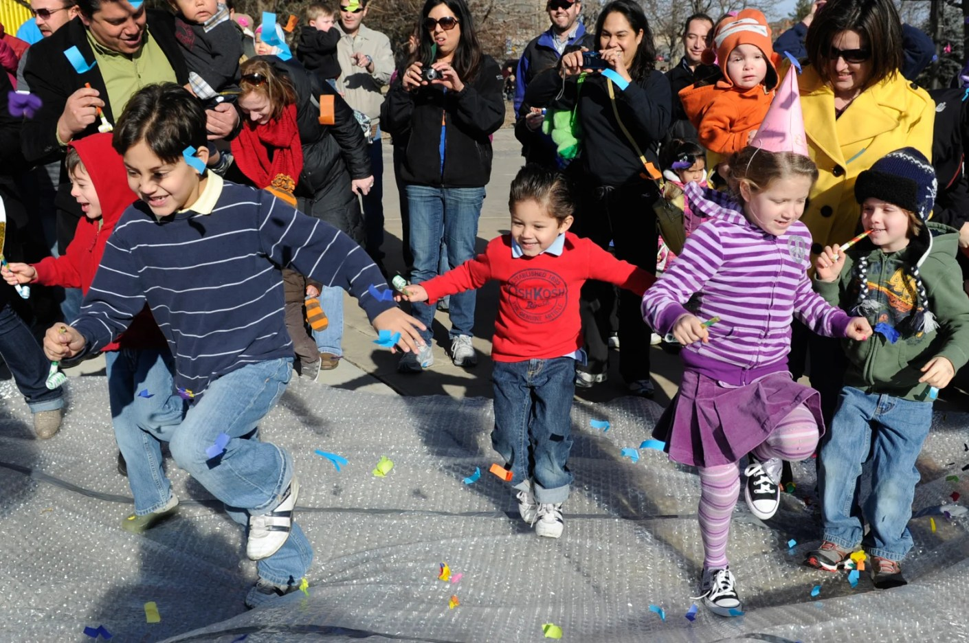 A large shiny ball makes its way down a pole as the count down takes place and the children are invited to jump up and down on a large sheet of bubble wrap as the Children