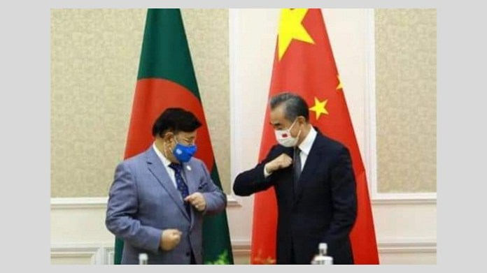 China State Councilor and Foreign Minister Wang Yi met with Bangladeshi Foreign Minister Dr. Momen in Tashkent on 15 july 2021