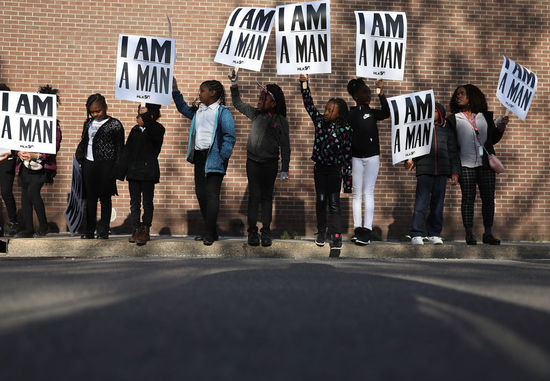 MEMPHIS, TN - APRIL 04: Children from Promise Academy Spring Hill hold 'I Am A Man' signs, in reference to the sanitation workers strike in 1968, as they participate in an event to mark the 50th anniversary of Dr. Martin Luther King Jr.'s assassination April 4, 2018 in Memphis, Tennessee. American civil rights leader King was killed on April 4, 1968 while supporting a sanitation workers strike in Memphis. (Photo by Joe Raedle/Getty Images)