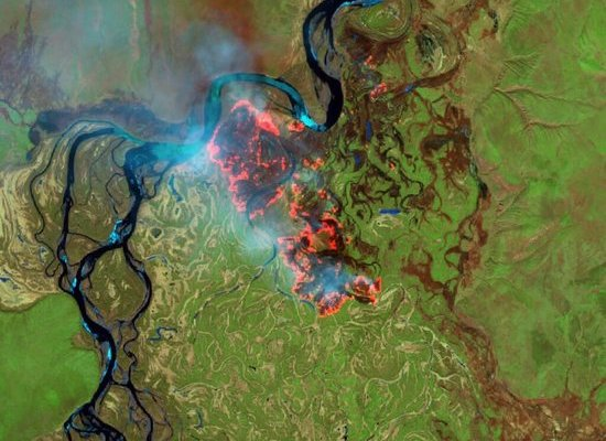 (May 2019) Batagay in the district of Verkhoyansk, within the Arctic Circle, in Siberia's Republic of Sakha There is still ice in lakes and rivers, but the tundra is on fire!