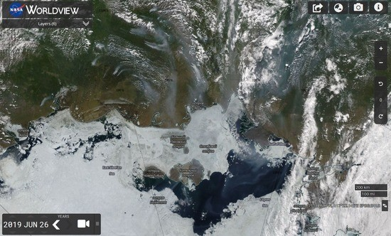 Wildfire smoke blackens the Arctic ice near the Laptev sea.
