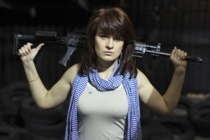 FILE - In this Sunday, April 22, 2012 filer, Maria Butina, a gun-rights activist, poses for a photo at a shooting range in Moscow, Russia. Accused of working as an undeclared foreign agent in the U.S., Butina is fast becoming a cause celebre at home. Russian government rhetoric portrays Butina, accused of working as an undeclared foreign agent in the U.S., as a martyr to U.S. paranoia and a victim of poor conditions in the jail where she's being held pending trial. (AP Photo/Pavel Ptitsin, File)