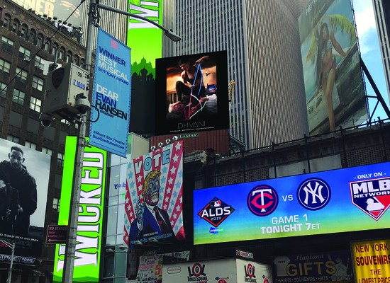 Dhavani advertisement in Times Square shows an athletic woman in Dhvani gear hog tying the President in front of the White House. October 2019. (Courtesy of Dhvani)