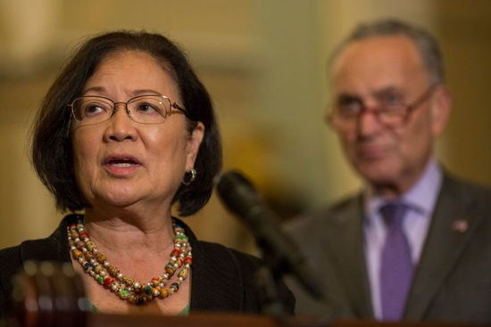 WASHINGTON, DC - AUGUST 21: Sen. Mazie Hirono (D-HI) speaks during a weekly news conference on Capitol Hill  on August 21, 2018 in Washington, DC. Pictured at right is Senate Minority Leader Chuck Schumer (D-NY).  (Photo by Zach Gibson/Getty Images)