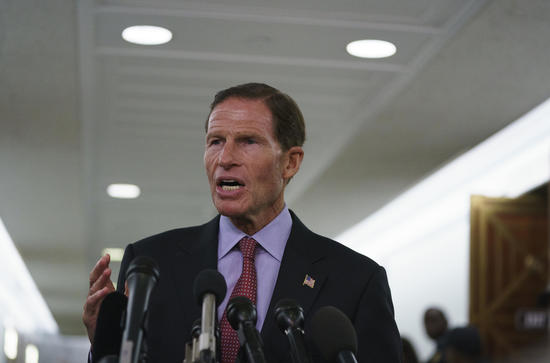 Senate Judiciary Committee member Sen. Richard Blumenthal, D-Conn., talks to media after a Senate Judiciary Committee hearing on Capitol Hill in Washington, Friday, Sept. 28, 2018. After a flurry of last-minute negotiations, the Senate Judiciary Committee advanced Brett Kavanaugh's nomination for the Supreme Court after agreeing to a late call from Sen. Jeff Flake, for a one week investigation into sexual assault allegation against the high court nominee. (AP Photo/Carolyn Kaster)