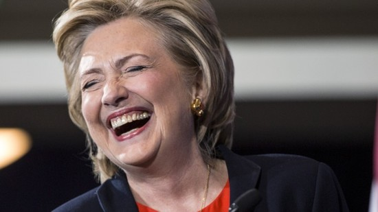 Democratic presidential candidate Hillary Clinton laughs before speaking to supporters at the Human Rights Campaign Breakfast in Washington, October 3, 2015. REUTERS/Joshua Roberts - RTS2V3R