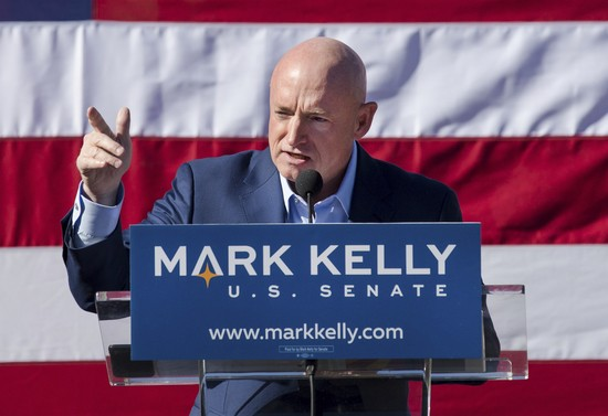 FILE - In this Feb. 23, 2019, file photo, Mark Kelly speaks during his senate campaign kickoff event in Tucson, Ariz. Arizona Republican Martha McSally has formally launched her campaign in one of the most hotly contested Senate races of the 2020 election. McSally has been hiring staff, raising money and campaigning for nearly a year but officially kicked off her election bid with a video posted Tuesday, Feb. 11, 2020, to her social media accounts. The 3 1/2-minute video offers a preview of McSally's message for the coming months. McSally is likely to face retired Democratic astronaut Mark Kelly in the November election. The winner will finish the last two years of the late Republican Sen. John McCain's last term in the Senate. (Mike Christy/Arizona Daily Star via AP, File)