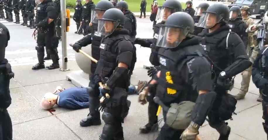 Buffalo police walk past 75-year-old Martin Gugino after shoving him violently to the ground