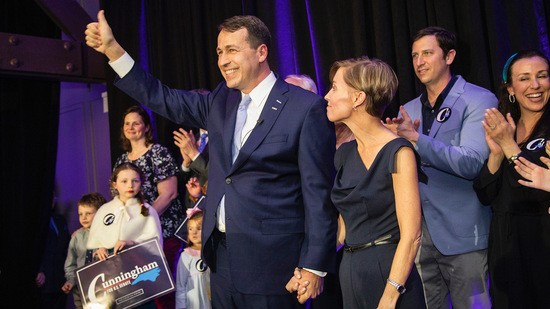 Democratic U.S. Senate candidate Cal Cunningham holds his wife Elizabeth's hand as he thanks the crowd after speaking during a North Carolina Democratic Party primary election watch party at Traine Raleigh Tuesday, March 3, 2020.