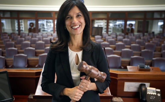 FILE - In this Nov. 29, 2018 file photo, Maine House Speaker Sara Gideon, D-Freeport, poses in the House Chamber at the State House in Augusta, Maine. Gideon is challenging incumbent Republican U.S. Sen. Susan Collins in the 2020 election. (AP Photo/Robert F. Bukaty, File)