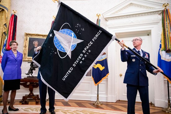 WASHINGTON, DC - MAY 15: Gen. Jay Raymond (R), Chief of Space Operations, and CMSgt Roger Towberman (L), with Secretary of the Air Force Barbara Barrett present US President Donald Trump with the official flag of the United States Space Force in the Oval Office of the White House in Washington, DC on May 15, 2020. (Photo by Samuel Corum-Pool/Getty Images)