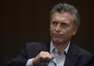 "Argentina's president elect Mauricio Macri gestures during a press conference in Buenos Aires on November 23, 2015 the day after winning the run-off election against the ruling ""Frente para la Victoria"" party candidate Daniel Scioli. Macri, a former football executive expected to be Argentina's most economically liberal leader since the 1990s, promised a ""marvelous"" new era for his country, beleaguered by years of economic instability.       AFP PHOTO / JUAN MABROMATA / AFP / JUAN MABROMATA        (Photo credit should read JUAN MABROMATA/AFP/Getty Images)"