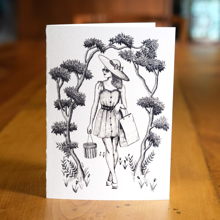 """This is the """"Afternoon Shopping"""" A7 Card. Leaves rustle in the breeze and tulips bloom as this woman enjoys the warm weather!"""