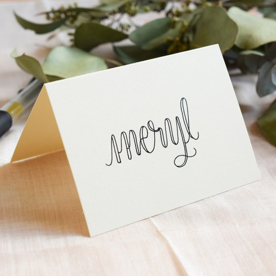 Amy Style calligraphy looks great whether you use a dip pen to create it or the faux calligraphy technique (shown on this place card).