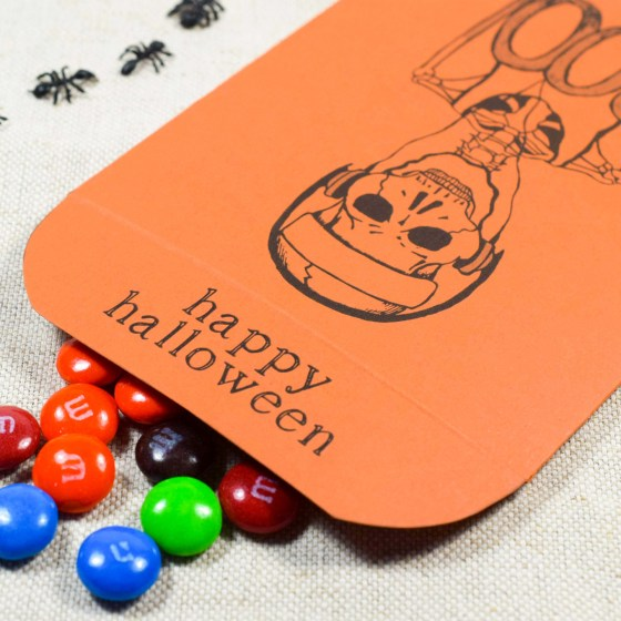 You can use this printable packet to put candy in for trick-or-treaters!