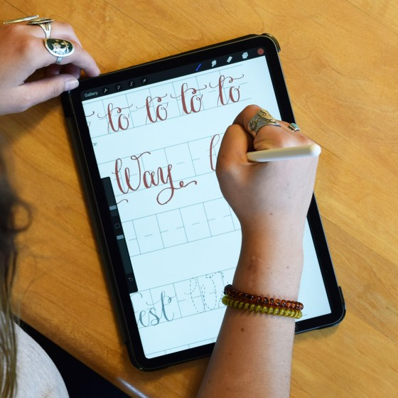 The worksheet features letter formation and word practice.