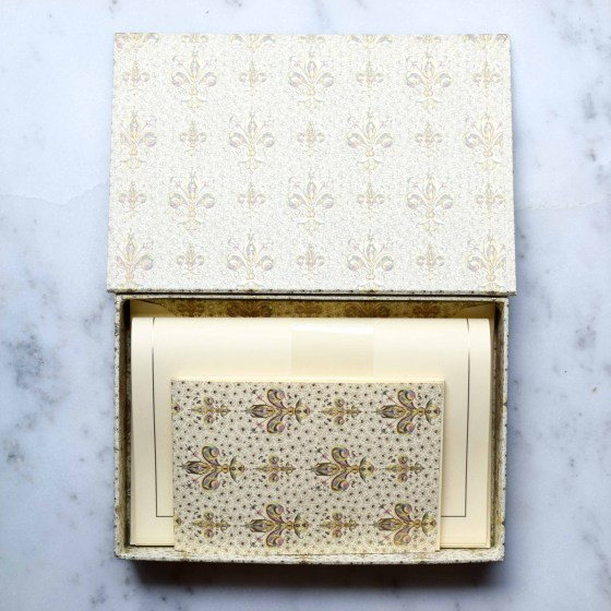 This luxe stationery set comes in a gorgeous box and includes a small notepad.