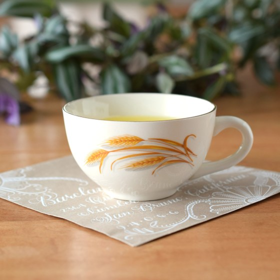 """This vintaThis vintage """"Golden Wheat"""" art water cup was made by the Homer Laughlin company in the 1960's.ge """"Golden Wheat"""" art water cup was made by the Homer Laughlin company in the 1940's."""