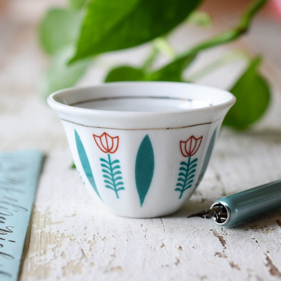 """This dainty """"Happy Tulip"""" art water cup will brighten any workspace!"""