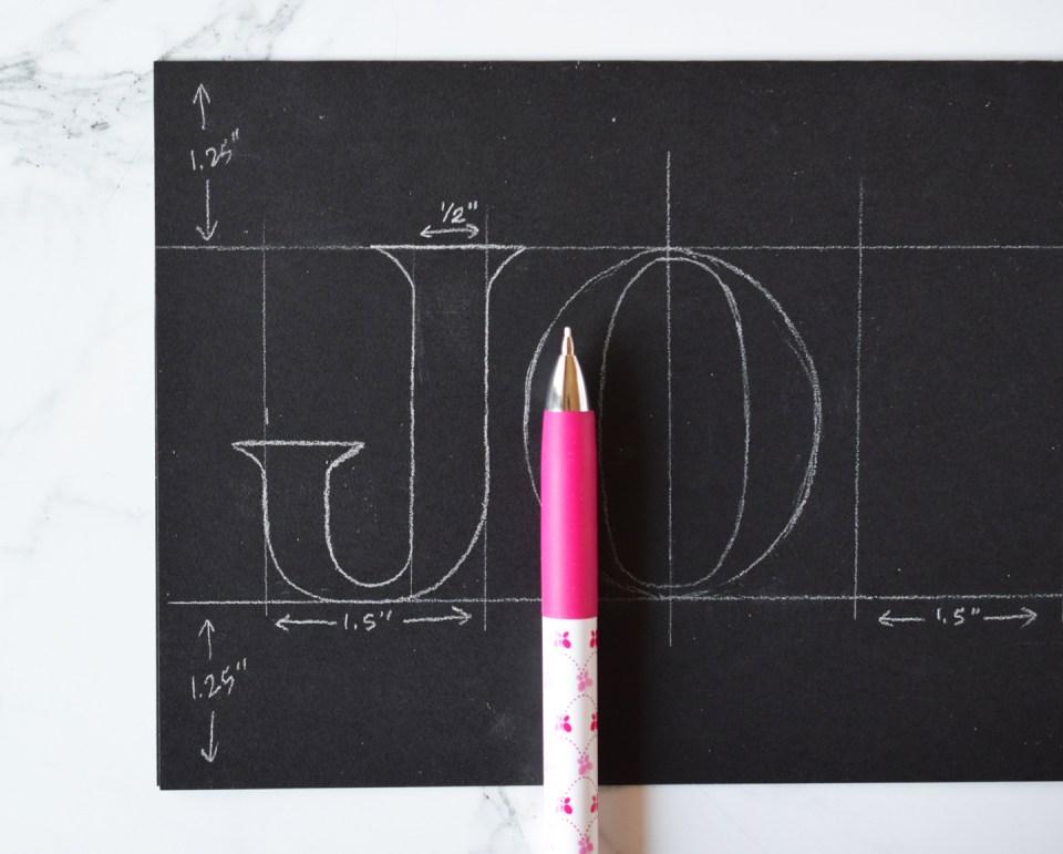 "Writing a ""J"" on the Christmas Card"