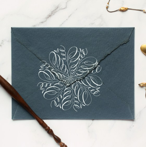 Calligraphy medallions are a great way to embellish envelopes. When your recipient turns the envelope over, they'll be greeted with an intricate surprise.