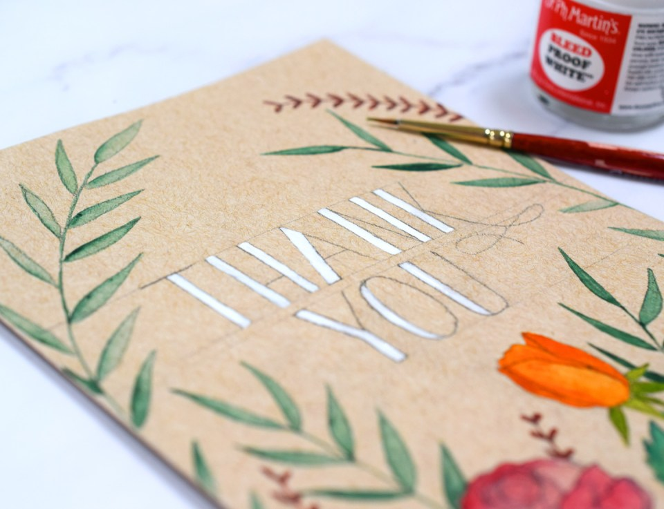 White lettering on a Watercolor Florals Kraft Card