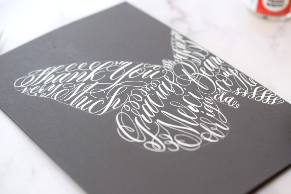 Calligraphy on a lace butterfly thank you card